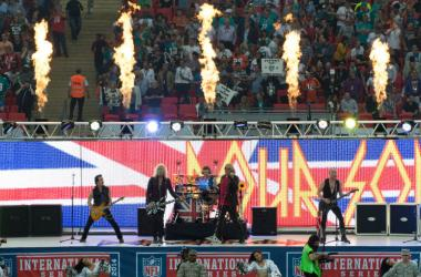 Def Leppard perform in the pre game show before the game between the Miami Dolphins and the Oakland Raiders at Wembley Stadium