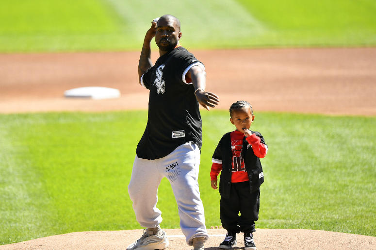Kanye West and his son Saint throw out a ceremonial first pitch before the game between the Chicago White Sox and the Chicago Cubs at Guaranteed Rate Field