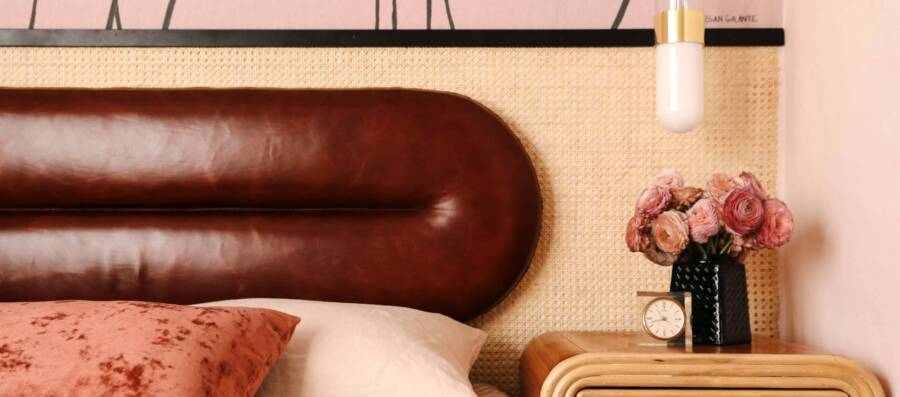 Headboard covered with leather by Cortina Leathers