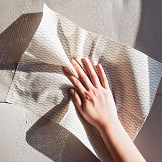 Wiping Clean Crypton Leather with disposable cloth