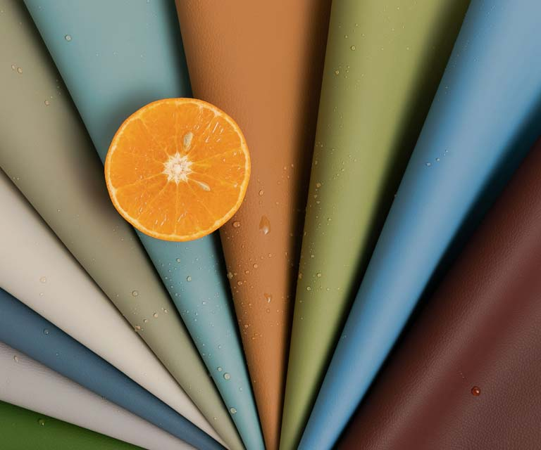 group of colors silicon fabrics and an orange slice