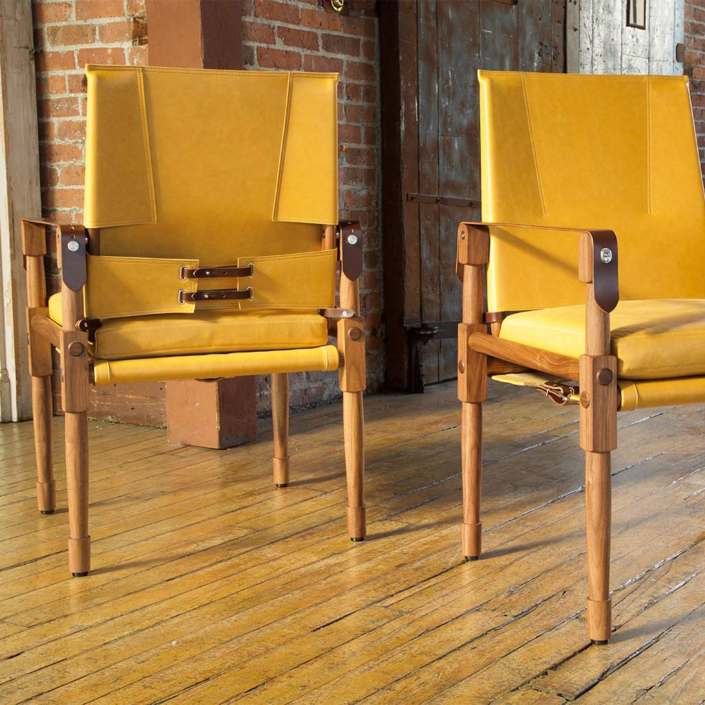 wooden stick frame chairs with leather top and back and leather strap hardware