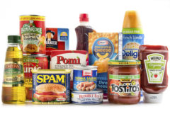 Miami, Florida, USA - June 1, 2015: Selection of brand name groceries. In full view are SPAM meat, Libby's Viena sausages, Pompeian Olive Oil, Heinz brand Tomato Ketchup, Bubble Bee Tuna, Tostitos Salsa, Chez Boyardee Spaghetti and meat balls. Other products are partially visible in the background.This is a collection of some of the basic staples found in many American kitchens. Other brands includes Kirkland, Quaker Oats, Pomi,Aunt Jemima, Kraft,Hunt's,and International delight.