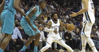 Memphis Grizzlies guard Mike Conley (11) handles the ball against Charlotte Hornets forward Marvin Williams (2) during the first half at FedExForum.