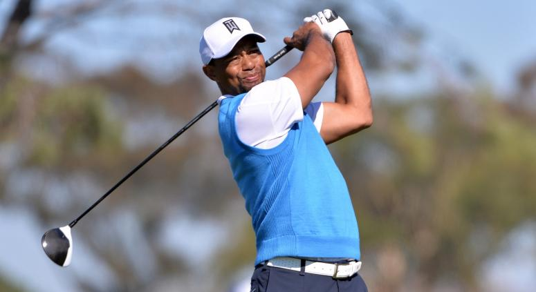 Tiger Woods tees off the 5th hole during the first round of the Farmers Insurance Open golf tournament at Torrey Pines Municipal Golf Course.