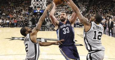 Memphis Grizzlies center Marc Gasol (33) is fouled while shooting by San Antonio Spurs power forward LaMarcus Aldridge (12) during the first half in game one of the first round of the 2017 NBA Playoffs at AT&T Center.