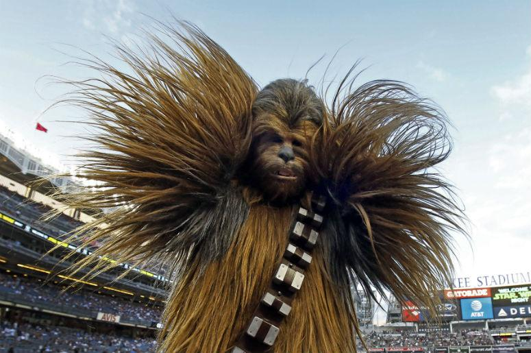 """Chewbacca participates in """"Star Wars"""" night prior to the Seattle Mariners taking on the New York Yankees at Yankee Stadium"""
