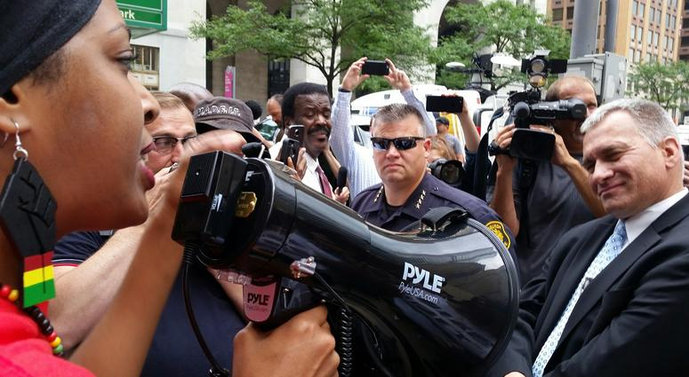 Demonstrator Confronting Wendell Hissrich