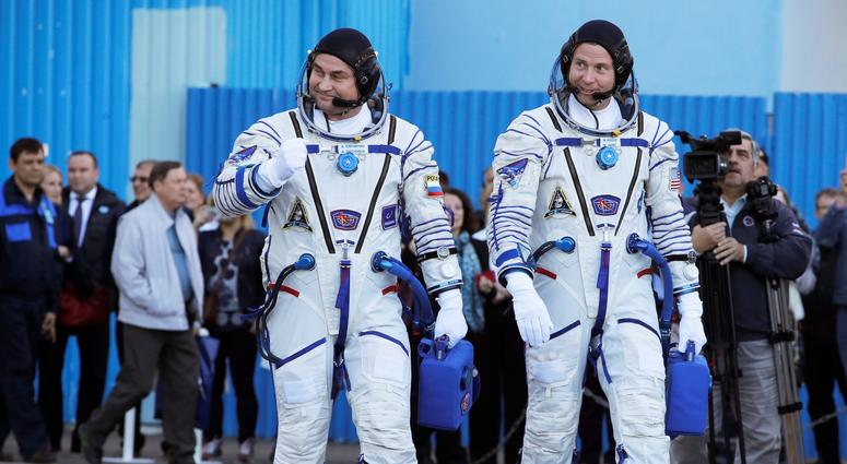 U.S. astronaut Nick Hague, right and Russian cosmonaut Alexey Ovchinin prior to the launch of Soyuz MS-10 space ship