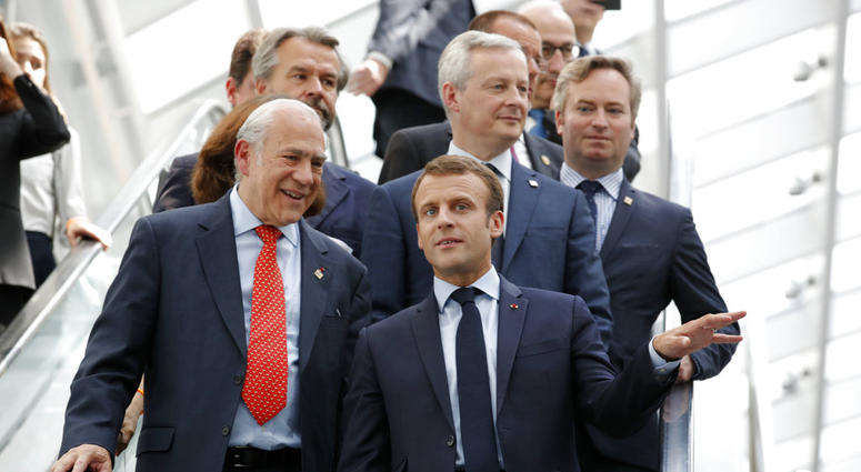 French President Emmanuel Macron and Organisation for Economic Co-operation and Development (OECD) Secretary-General Angel Gurria