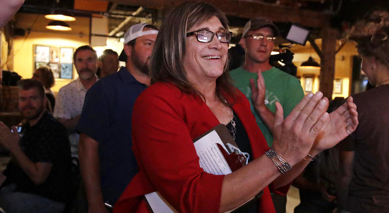 Vermont Democratic gubernatorial candidate Christine Hallquist, a transgender woman and former electric company executive, applauds with her supporters during her election night party in Burlington, Vt.