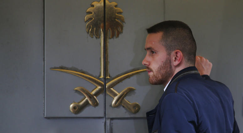 A man waits to enter Saudi Arabia's consulate in Istanbul, Friday, Oct. 19, 2018