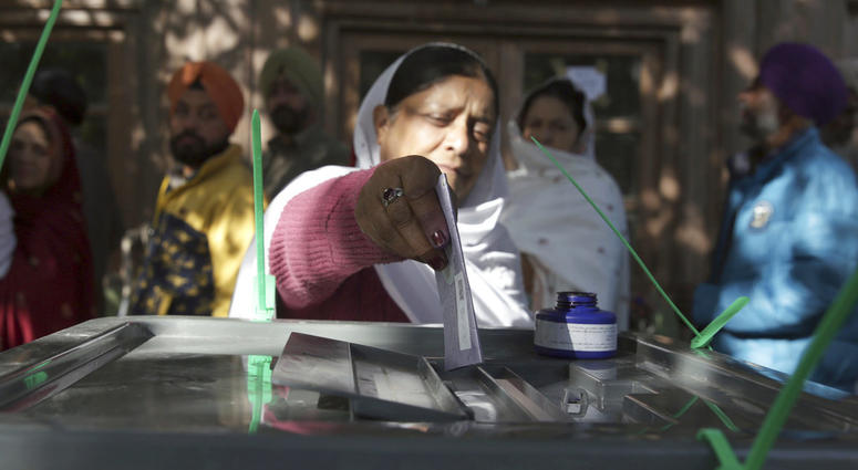 A woman from the minority Sikh casts her vote in Parliamentary elections in old city of Kabul, Afghanistan,