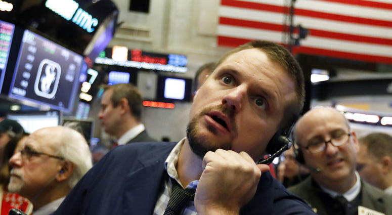 In this Oct. 19, 2018, file photo trader Michael Milano works on the floor of the New York Stock Exchange.