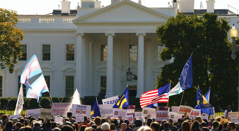 The National Center for Transgender Equality, NCTE, and the Human Rights Campaign gather on Pennsylvania Avenue in front of the White House