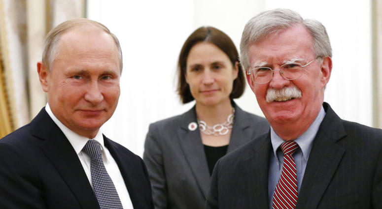 Russian President Vladimir Putin and U.S. National security adviser John Bolton