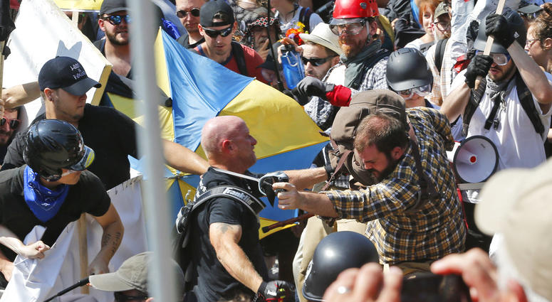 white nationalist demonstrators clash with counter demonstrators at the entrance to Lee Park in Charlottesville, Va.