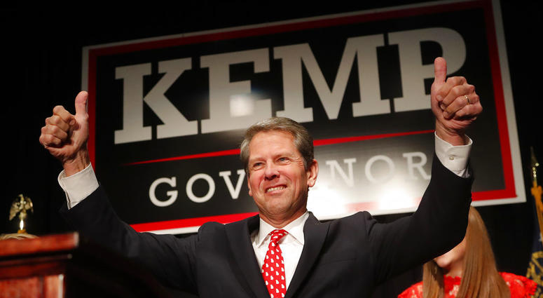 Georgia Republican gubernatorial candidate Brian Kemp gives a thumbs-up to supporters, Wednesday, Nov. 7, 2018, in Athens, Ga