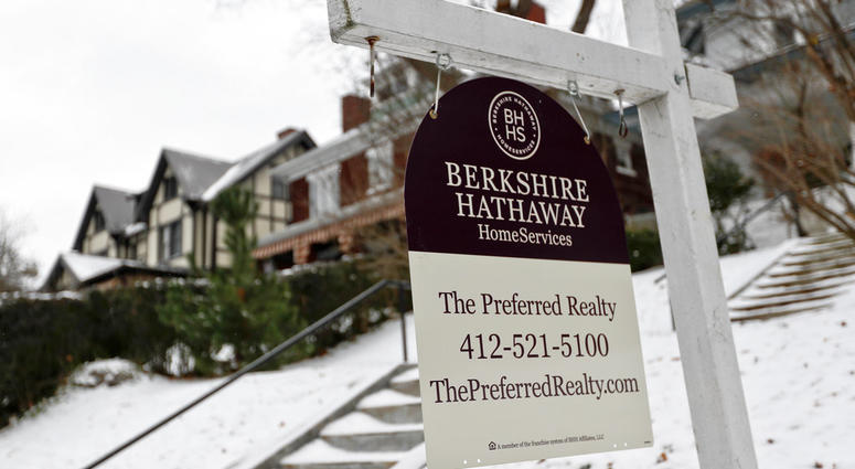 A realtor sign hangs in front of a home for sale in Pittsburgh