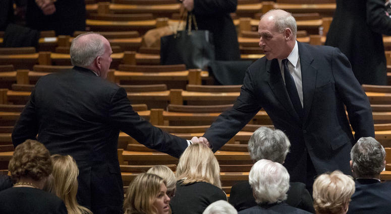 Former CIA Director John Brennan, left, shakes hands with President Donald Trump's Chief of Staff John Kelly, right,