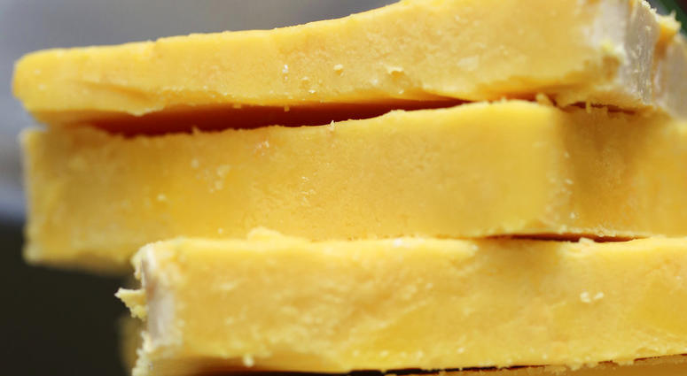 The practice of adding color to cheddar cheese reaches back to when cheesemakers in England skimmed the butterfat from milk to make butter