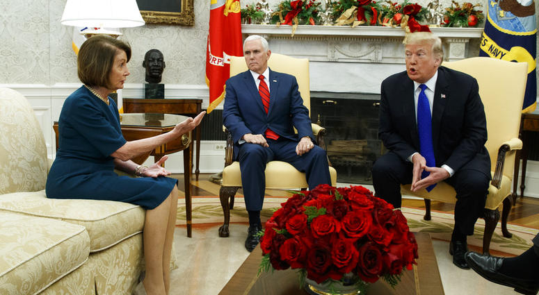 Vice President Mike Pence, center, looks on as House Minority Leader Rep. Nancy Pelosi, D-Calif., and President Donald Trump argue during a meeting in the Oval Office of the White House, Tuesday, Dec. 11, 2018, in Washington.