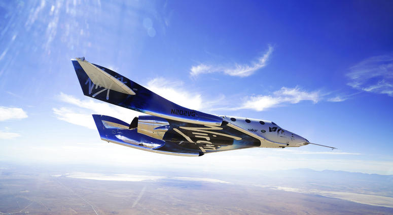 This May 29, 2018 photo provided by Virgin Galactic shows the VSS Unity craft during a supersonic flight test.