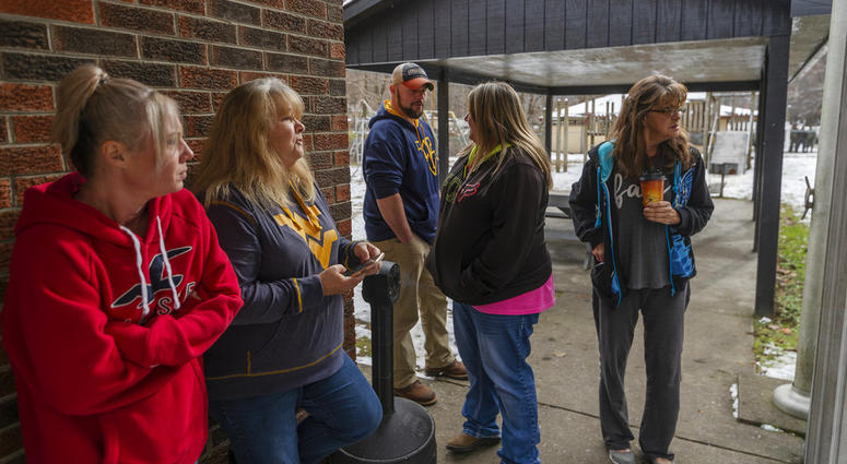 Family and friends await word of the search teams efforts in finding Cody Beverly, Kayla Williams and Erica Treadway at the Salamy Memorial Center in Whitesville, W.Va.,