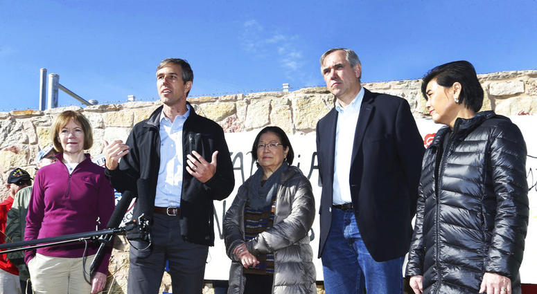 U.S. Rep. Beto O'Rourke, D-El Paso, second from left, speaks with four other Democratic members of Congress after touring the Tornillo international port of entry where several thousand immigrant teens are being housed Saturday, Dec. 15, 2018, east of El