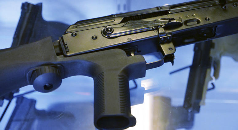 """a little-known device called a """"bump stock"""" is attached to a semi-automatic rifle"""