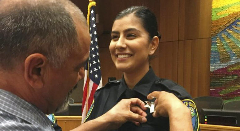 Williams Pioneer Review shows Merced Corona, left, pins his daughter Natalie Corona's badge on her uniform during a swearing-in ceremony in Davis