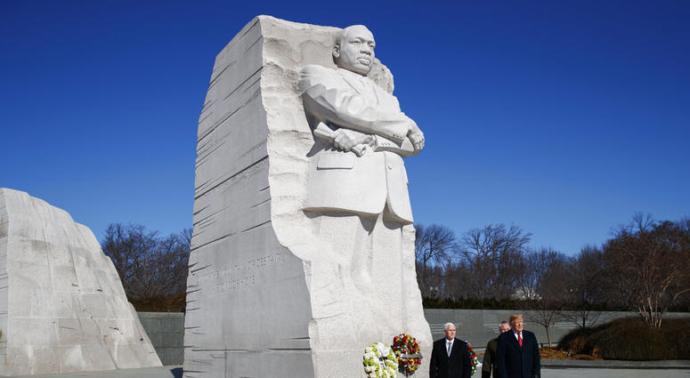 President Donald Trump, right, and Vice President Mike Pence, left, visit the Martin Luther King Jr. Memorial, Monday, Jan. 21, 2019, in Washington
