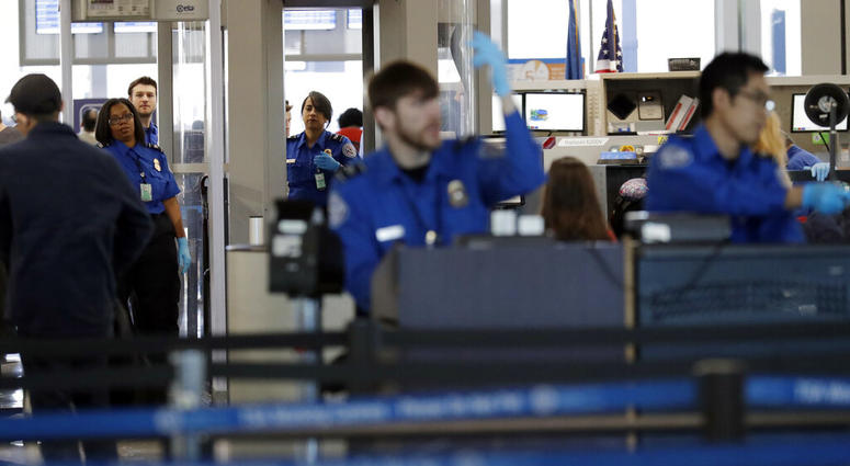 Transportation Security Administration officers work at a checkpoint at O'Hare airport in Chicago