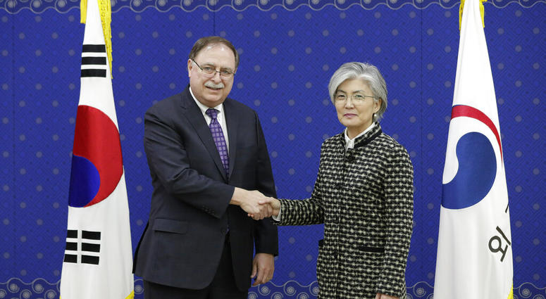 South Korean Foreign Minister Kang Kyung-wha, right, and Timothy Betts, acting Deputy Assistant Secretary and Senior Advisor for Security Negotiations and Agreements in the U.S. Department of State, shake hands for the media before their meeting at Foreig