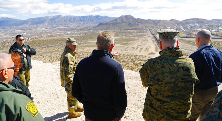 Acting Secretary of Defense Patrick Shanahan, center, and Joint Chiefs Chairman Gen. Joseph Dunford, second from the right, looks across the horizon during a tour of the US-Mexico border at Santa Teresa Station in Sunland Park, N.M.,