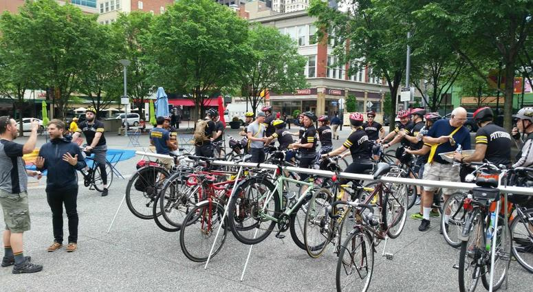 """Hundreds of bicyclists stopped by """"Commuter Cafes"""" set up at Market Square downtown and Schenley Plaza in Oakland to mark 2018 Bike to Work Day."""