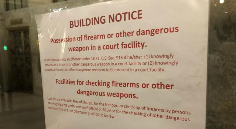 The city of Pittsburgh has responded to a threat of legal action over signs posted outside the City-County Building warning that weapons are not allowed inside.