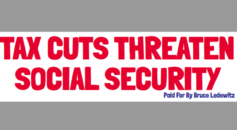 "A red and white billboard reading ""tax cuts threaten social security"""