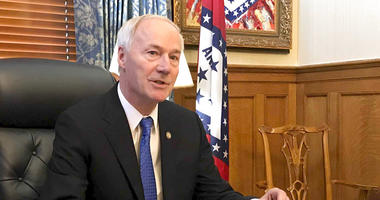 """Arkansas Gov. Asa Hutchinson speaks to reporters in his office at the state Capitol in Little Rock, Ark., Wednesday, April 10, 2019, about a bill prohibiting """"sanctuary cities"""" that don't cooperate with federal immigration authorities. The governor said W"""