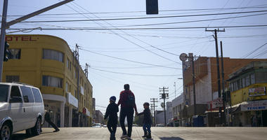 Ruth Aracely Monroy walks with her sons in Tijuana, Mexico