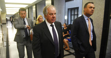Attorneys Jack Goldberger, center, Alex Spiro, left, and William Burck, the defense team for New England Patriots owner Robert Kraft, make their way to Courtroom 2E at the Palm Beach County Courthouse, Friday, April 12, 2019, in West Palm Beach, Fla., for