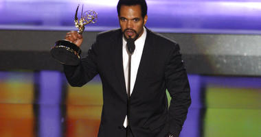 """Kristoff St. John accepts the award for outstanding supporting actor in a drama series for his work on """"The Young and the Restless"""" at the 35th Annual Daytime Emmy Awards in Los Angeles"""