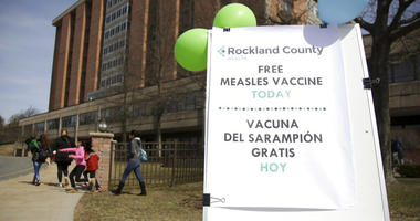 A sign advertising free measles vaccines is displayed at the Rockland County Health Department in Pomona, N.Y.,