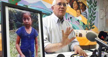 Annunciation House director Ruben Garcia answers questions from the media after reading a statement from the family of Jakelin Caal Maquin, pictured at left, during a press briefing at Casa Vides in downtown El Paso, Texas.
