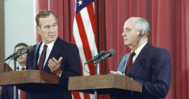 President George H.W. Bush gestures during a joint news conference with Soviet President Mikhail Gorbachev