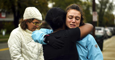 Simone Rothstein, right, 16, hugs a person who doesn't want to be identified on the intersection of Shady Avenue and Northumberland Street after multiple people were shot at The Tree of Life Congregation synagogue