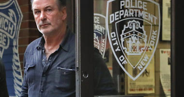 Alec Baldwin walks out of the New York Police Department's 10th Precinct