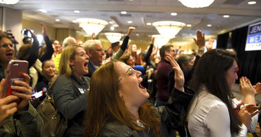 Stephanie Anderson screams as Virginia's 10th congressional district is called for Democrat Jennifer Wexton