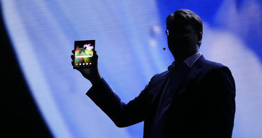 Justin Denison, SVP of Mobile Product Development, shows off the Infinity Flex Display of a folding smartphone during the keynote address of the Samsung Developer Conference