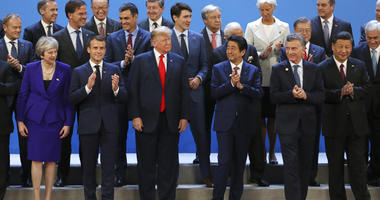 World leaders gather for a group photo at the start of the G20 Leader's Summit at the Costa Salguero Center in Buenos Aires, Argentina